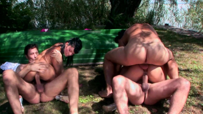 Black Angelika and Lucy Belle shows at their best as they serve no less than three guys at the lake side